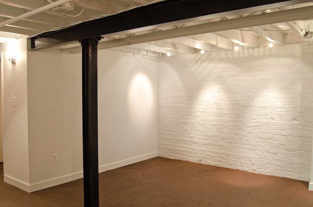 White walls, white ceiling basement.