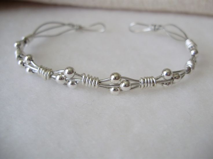 Silver wire-wrapped bracelet --  Enameled copper wire & silver plated beads. 20 gauge wire makes  this bracelet stiff enough to wear as a cuff, but adjustable enough to bend.  #handmade #jewelry #wire_wrapping