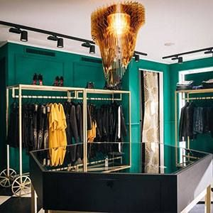 From museum to a trending fashion boutique: the Aria Gold chandelier by Zaha Hadid Design suits every space perfectly. Pictured in ToffeeSanremo boutique by #IngridNinaToffee, the very chic and cool owner.  More at www.slamp.com!