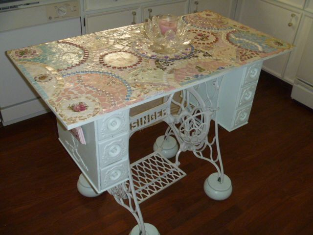 Kitchen island from old Singer sewing machine cabinet, a wood top and old china mosaic!