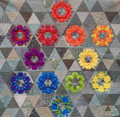 Join us for a 12-month quilt block of the month! Whether you're trying English Paper Piecing for the first time, or you're firmly addicted, you'll love the bright colors and intricate designs of this project.