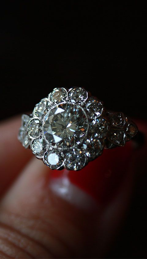 Made to sparkle in the darkest light. This Edwardian ring features an old European-cut center diamond. Only at Isadoras.com.
