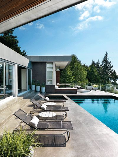 What's not to love about a beautiful pool deck sitting cliff-side looking off into the ocean? #WesternLiving