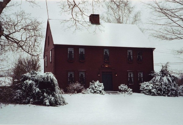 Beautiful red saltbox house in winter. I wonder if I made a mistake painting my house blue?