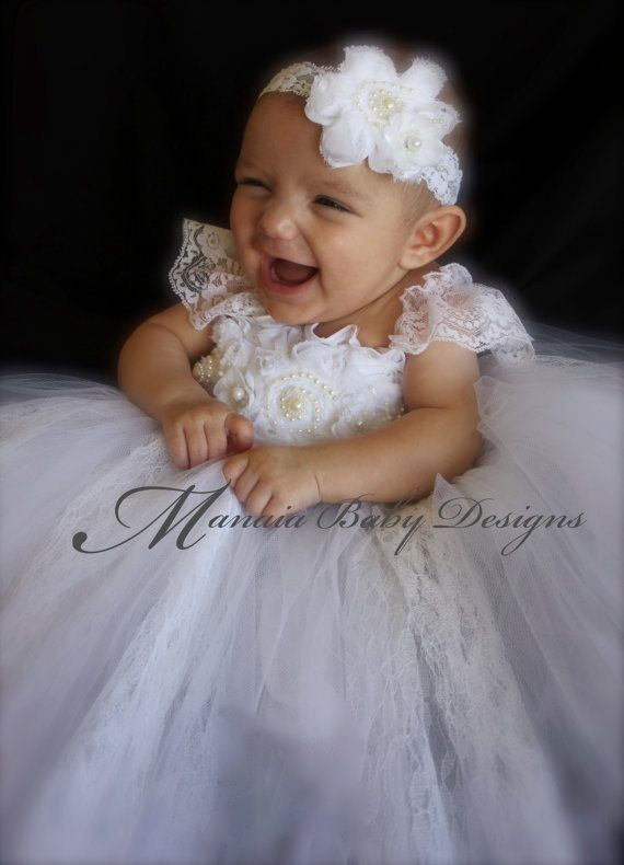 Its the perfect, simple, yet elegant, dress for your babys special day. 2 layers of white tulle attach to a white crochet baby-doll style top.