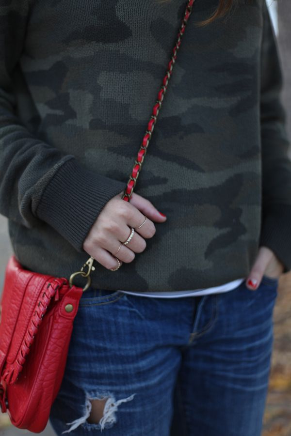 Red bag + camo sweater.