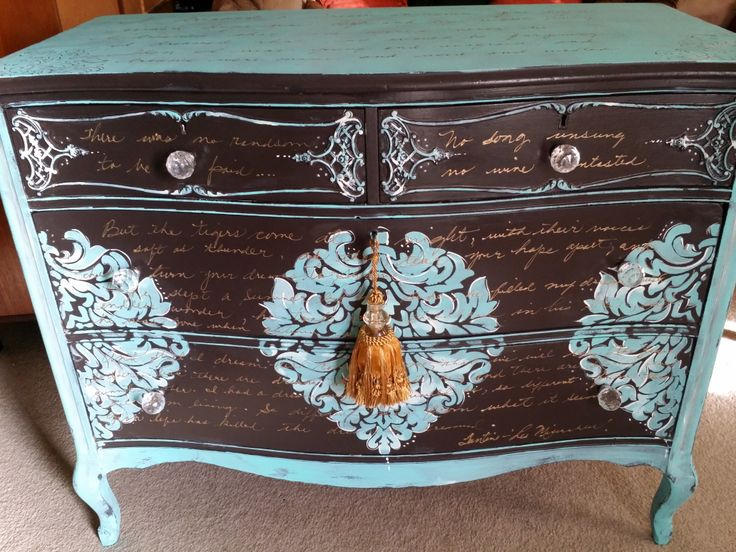 "Antique Victorian Dresser painted espresso then splashes of turquoise and gold. I have also added the entire song from Les Miserable ""I Dreamed A Dream"" across the top and down the front in gold.  https://www.facebook.com/pages/The-Dwelling-Place/208843295993325"