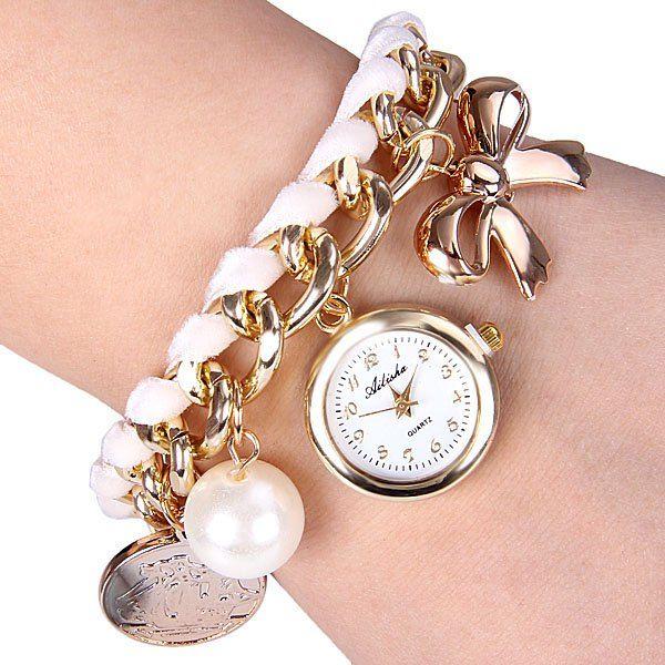 Hermoso reloj de pulsera color blanco con toques dorados y cuentas decorativas.  o  $6.990