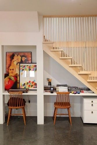 This extensive basement renovation makes the most of the space under the stairs. The homeowner also thought up the idea of creating a slat wall to use as a staircase railing. This move emphasizes verticality in this previously too-short space; originally 6 feet 4 inches high, the renovation extended it to 8 feet 6 inches high. In fact, this homeowner's blog is called 8foot6.