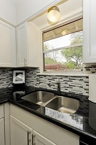 Kitchen With Custom Glass And Marble Tile Backsplash