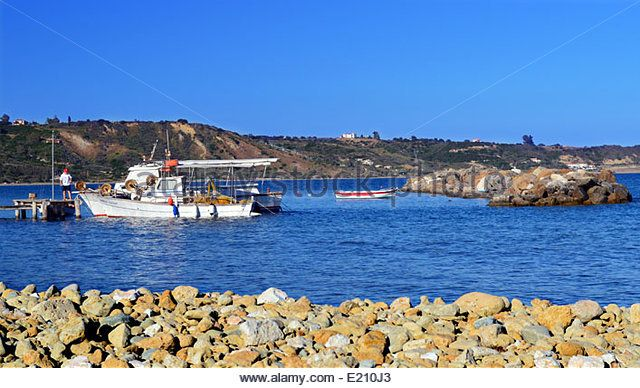 Fishing Boats Tied to Wooden Jetty in Katelios on the Greek Island of Kefalonia - Stock Image
