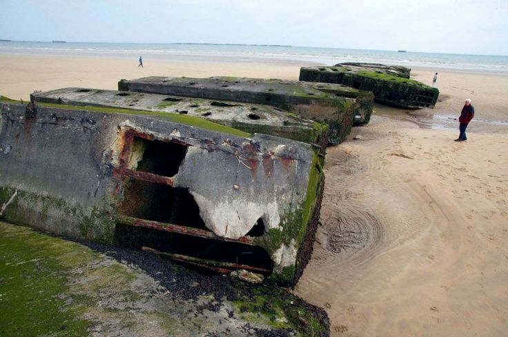 """Normandy Beach, Arromanches, north France. Remains of the Allied """"floating pier""""."""