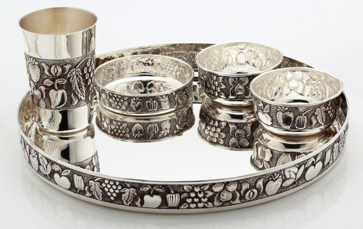 A traditional silver thali set...