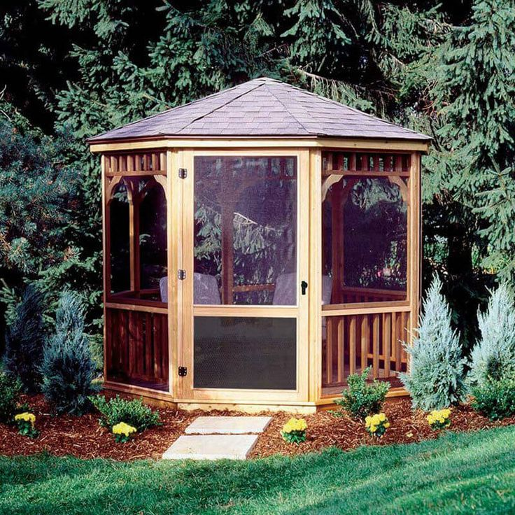 This small screened gazebo is a suitable place for a couple of chairs so you can sit around in your yard and enjoy the garden without getting harassed by bees and other insects.