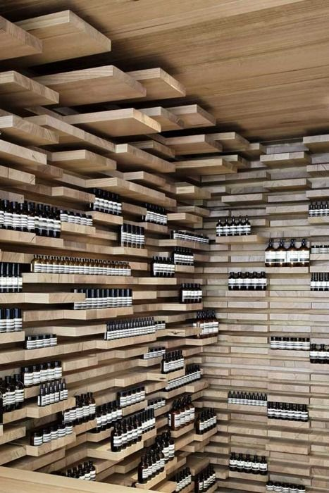Aesop, shelving that is moulded like a landscape cliff to house the product, helps associate the product as natural.