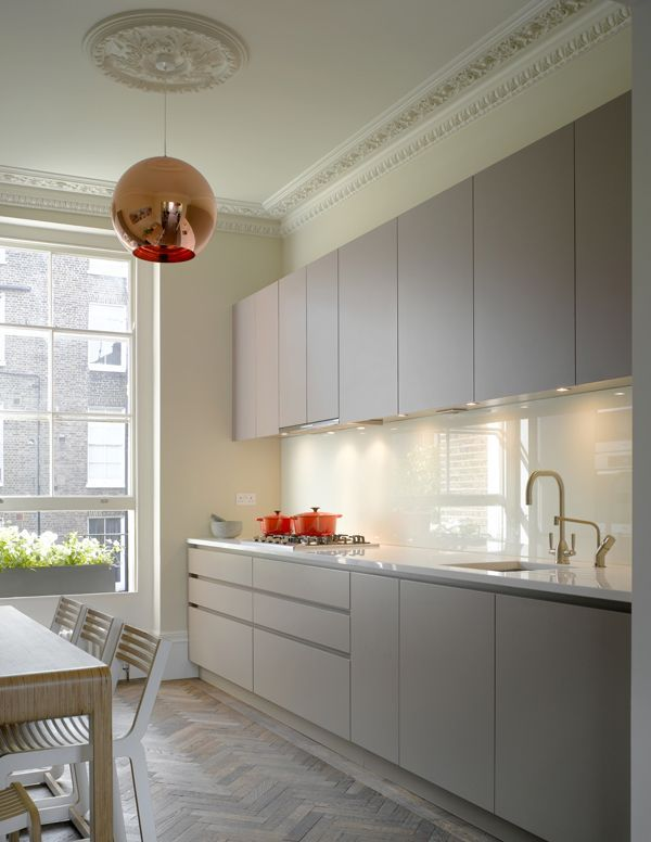 Roundhouse bespoke Urbo kitchen in a galley layout. Copper hanging light. Herringbone floor.