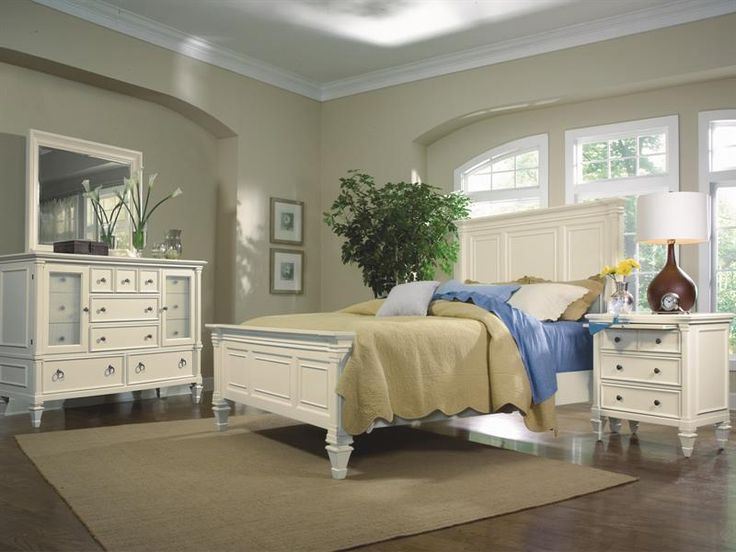 71900 - Ashby  Ashby features a patina white finish with contrasting fired nickel hardware and reeded glass. Its urban cottage style harkens back to a more simple time and place. These pieces mix comfortably with other timeless furnishings. Ashby is crafted of hardwood solids and molded composites. Drawer construction features French dovetailing in fronts, English in the backs. Wood on wood drawer. guides are also used.