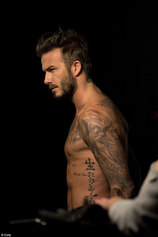 David Beckham is suited and booted for football pitch photoshoot | Daily Mail Online