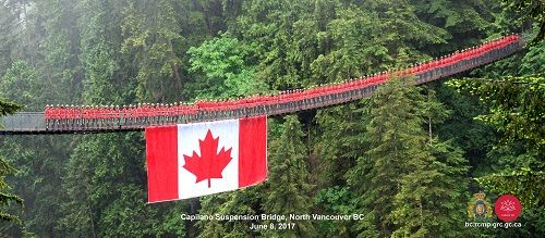 Over a 100 Mounties muster on Capilano Suspension Bridge to wish Canada happy birthday. June 8, 2017