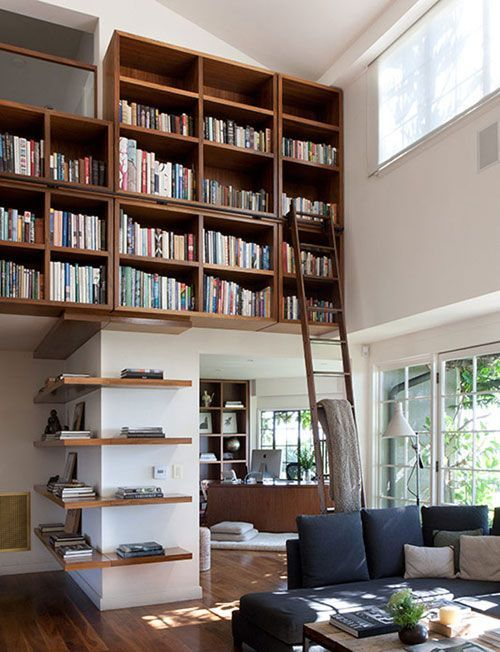 Love books and this is a great bookshelf idea reminds me of old time libraries a bit with the ladder great idea if you have high ceilings but not a lot of