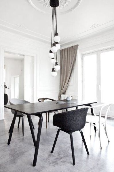 Concrete floors and white walls - http://cimmermann.co.uk/blog/dining-tables-favourites/