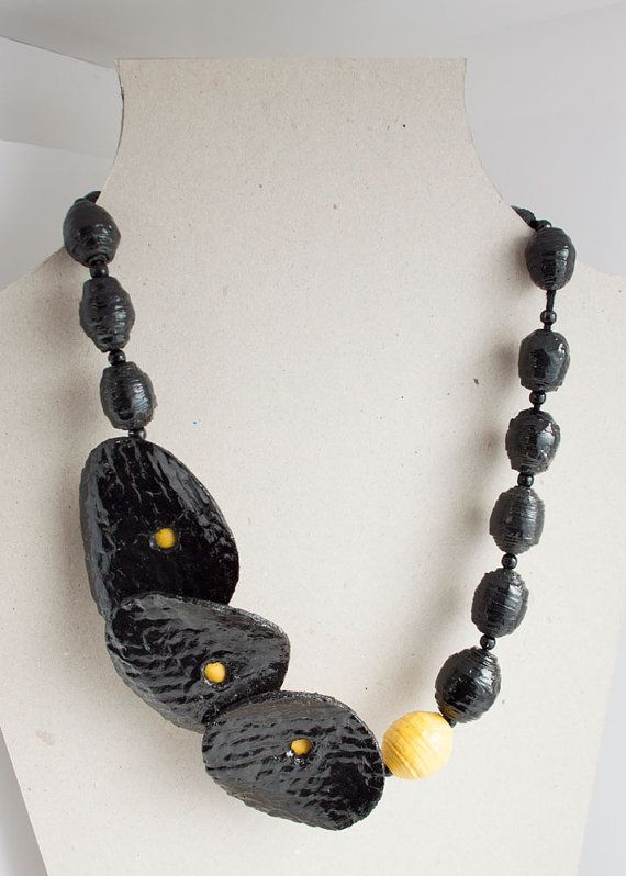 This black and yellow necklace takes inspiration from design of high fashion jewelry, but is entirely handmade!