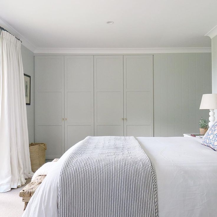 Modern farmhouse bedroom with shiplap cladding, custom joinery, linen curtains, ticking stripe bedlinen by Wallace Cotton NZ | Photo, design and styling by @cottonwoodinteriors