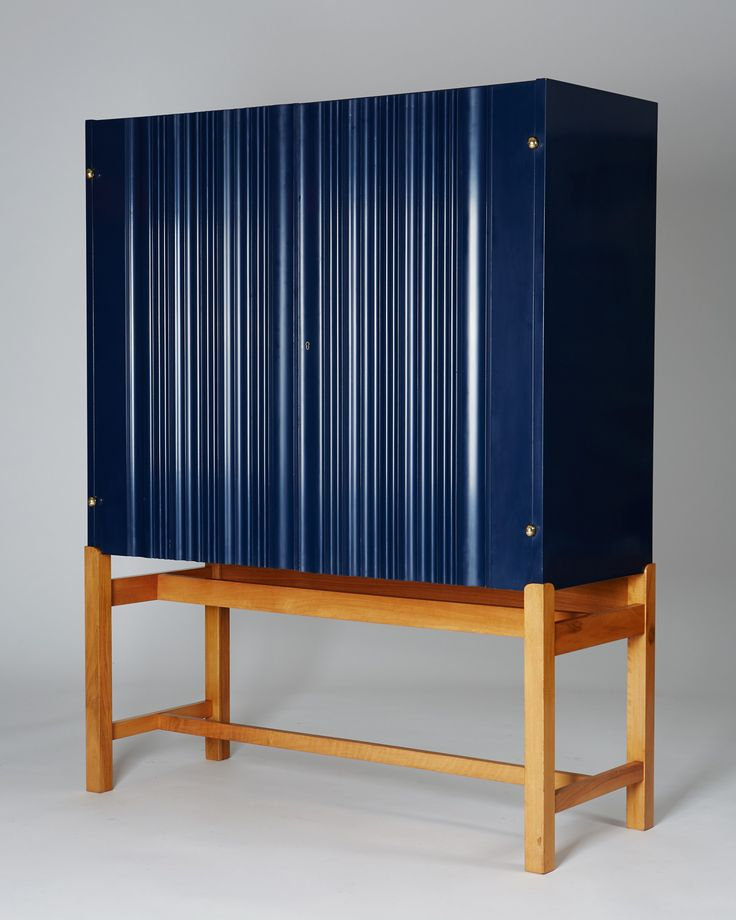 Josef Frank; Lacquered Wood, Walnut and Brass Cabinet for Svenskt Tenn, 1950s.