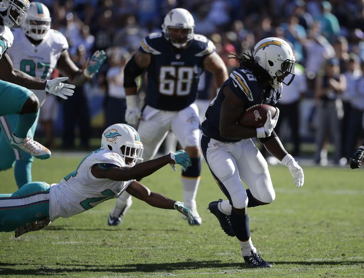 Dolphins vs. Chargers:  31-24, Dolphins  -  November 13, 2016  -   Melvin Gordon runs past Miami Dolphins strong safety Isa Abdul-Quddus during the first half of an NFL football game in San Diego, Sunday, Nov. 13, 2016. (AP Photo/Gregory Bull) AP, GREGORY BULL