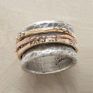 FLOW OF LIFE RING  Three rotating 14kt bands (two yellow gold, one rose) represent the endless flow of life.
