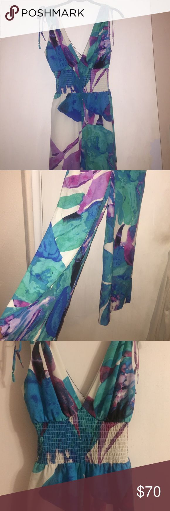 Bebe jumpsuit Bebe colorful vneck jumpsuit with stretchy band and flowy pants. Only worn once, looks brand new, and is in great condition bebe Other