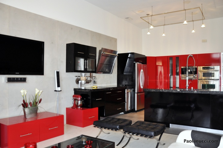 Red and Black decor at a home. Owner blends the family area with the kitchen keeping the same colors to make the space look bigger.