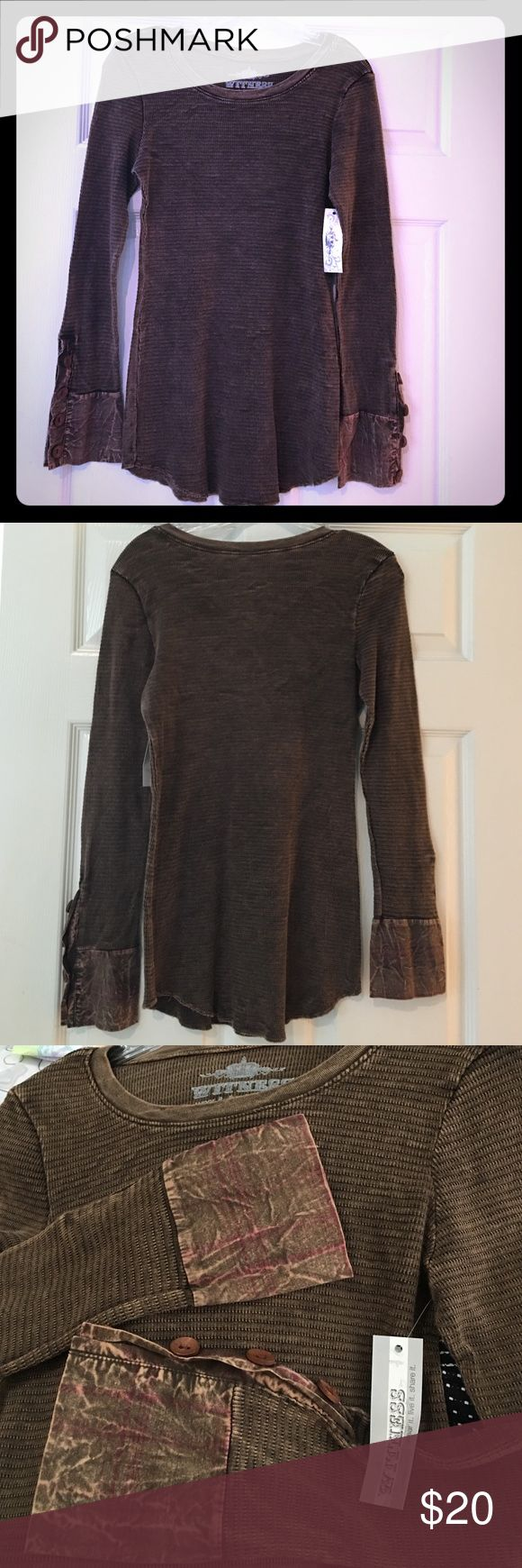 Witness brown long sleeve top Given to me as a gift and I have no prayer of ever fitting into it. The label says large but in no way, shape, or form would I describe this as a large. It's barely even a medium. It's a long length, but super snug across the bust and tummy. There's a lot of stretch.  It's cute and unique, but it's never going to work on me.  Witness brown long sleeve top Witness Tops Tees - Long Sleeve