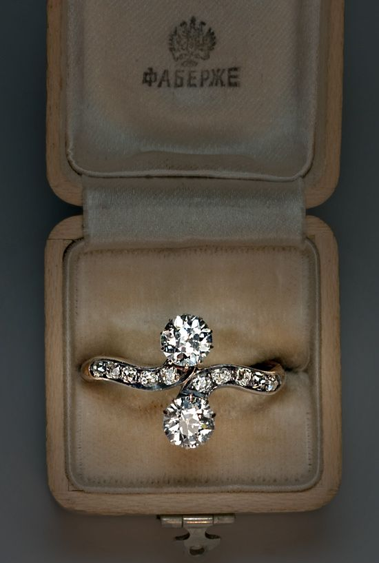 An extremely rare FABERGE crossover engagement ring (only a few items exist), made between 1890s and 1904, St Petersburg. Both diamonds are of European cut and their total weight is 1,5 ct. Probably, these diamonds were a part of earrings or a necklace that once belonged to a rich family before a new owner decided to impress his bride. The mark of fashionable Faberge workshop that produced only a few rings costed more than these diamonds so only a rich heir could allow himself to pay a…