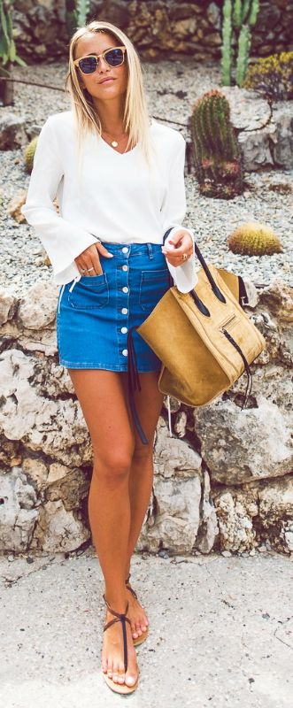 pinterest ↠ dianaghigliotti  Pair your little button front denim mini skirt with a simple white bell sleeve blouse. Adorable. Via Janni Deler Sunglasses: RayBan, Top: Chiquelle, Skirt: Gina Tricot, Bag: Céline, Sandals: Bershka