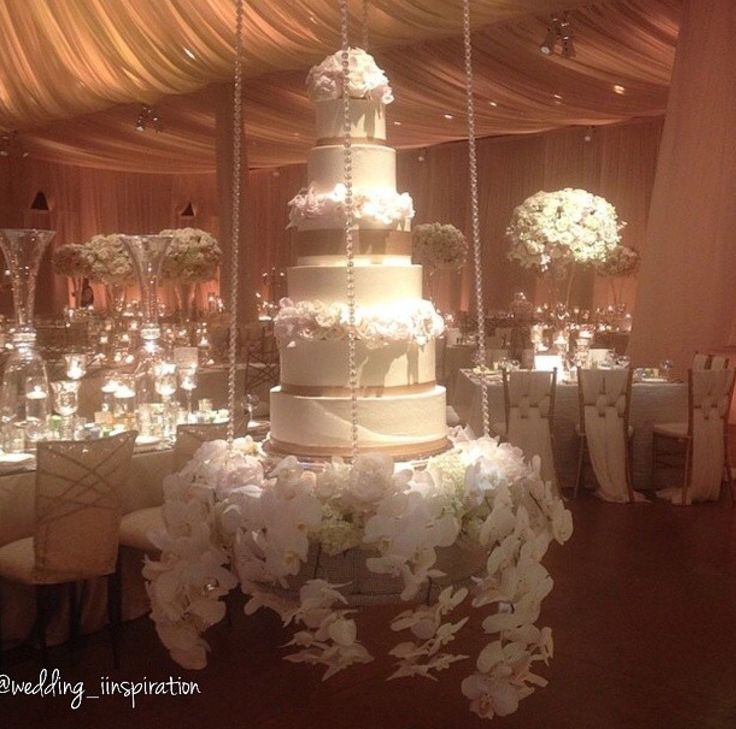 cakes on a cake table or on a cake stand is not enough for 2014 couples right now cakes have to be suspended smothered in crystals flowers bling