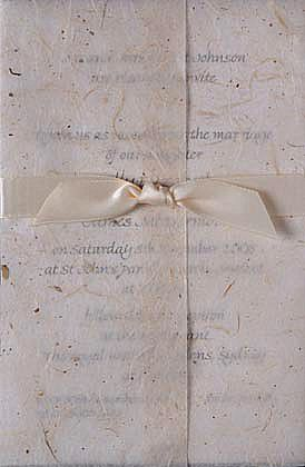 A vintage wedding invitation using ribbon and glitter paper.www.kardella.com