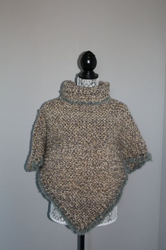 Hand made poncho with cowl neck in tweed patterned yarn with grey and beige flecks. Fits small-medium size. Great for wear over a light