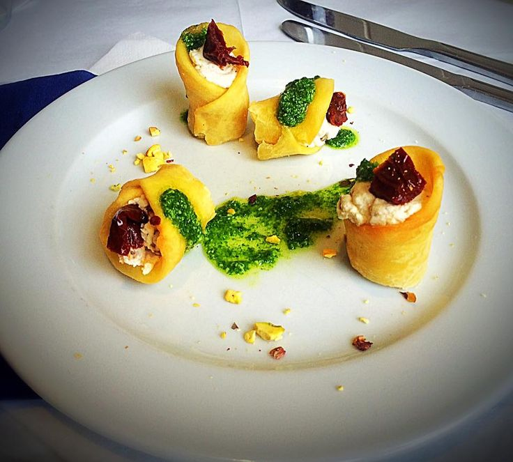 Our Chef Ciro lets us try his suggestion for the upcoming Specials. It doesn't just look good, it also tastes incredible. What you see are Savory Pastry Rolls filled with Ricotta and Sundried Tomatoes, with a Rocket Pesto and Crushed Pistachio Nuts.