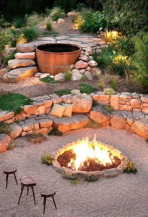 The 5-foot-diameter lava rock–topped pit blazes with gas-fed flames, while a sandstone wall, scattered with cushions for comfort, serves as seating between the hot tub and fireplace | Sunset