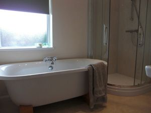 Just what you need after a walk up the hills! Relax in our roll top bath!