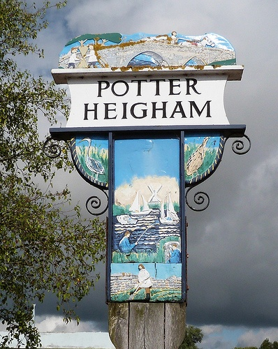 Potter Heigham sign by Matt1138 on Flickr.  There is another, square shaped, sign for Potter Heigham further up the page.