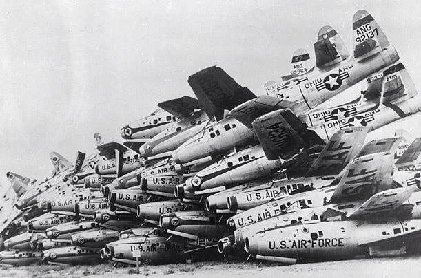 Surplus F84 Thunderjets piled up like firewood.