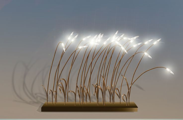 Wind, lampe à poser, est traversé d'un souffle poétique qui incline ses longues tiges souples au bout desquelles s'épanouit un cristal de roche. Saisir l'instan