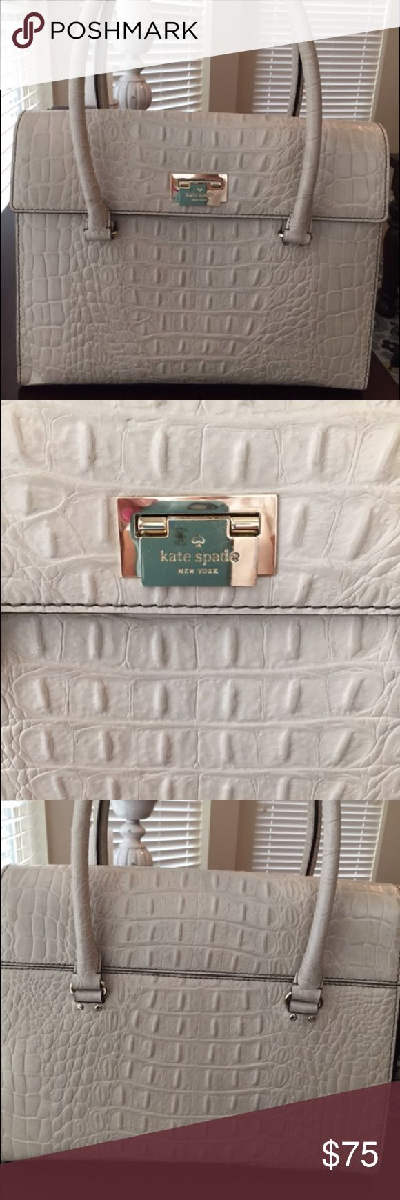 Kate Spade Creme Crocodile Handbag Structured purse with gold accents and feet.  Good condition.  Clean on the inside.  Some wear on the handles.  Used 1 season. kate spade Bags Satchels