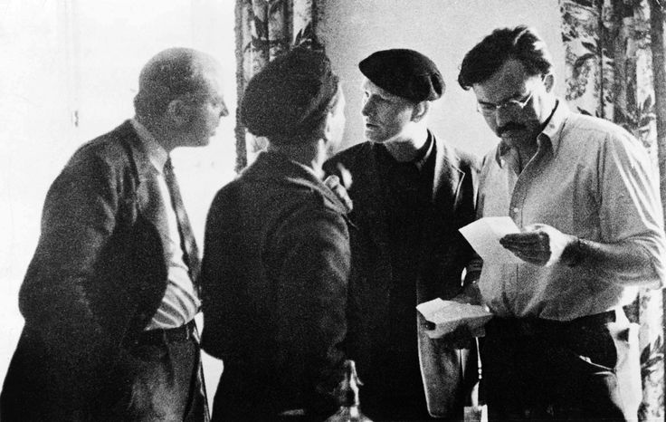 Lost Generation:   Ernest Hemingway (far right) with John Dos Passos (far left), Joris Ivens (back to camera), and Sidney Franklin in Madrid during the Spanish Civil War.