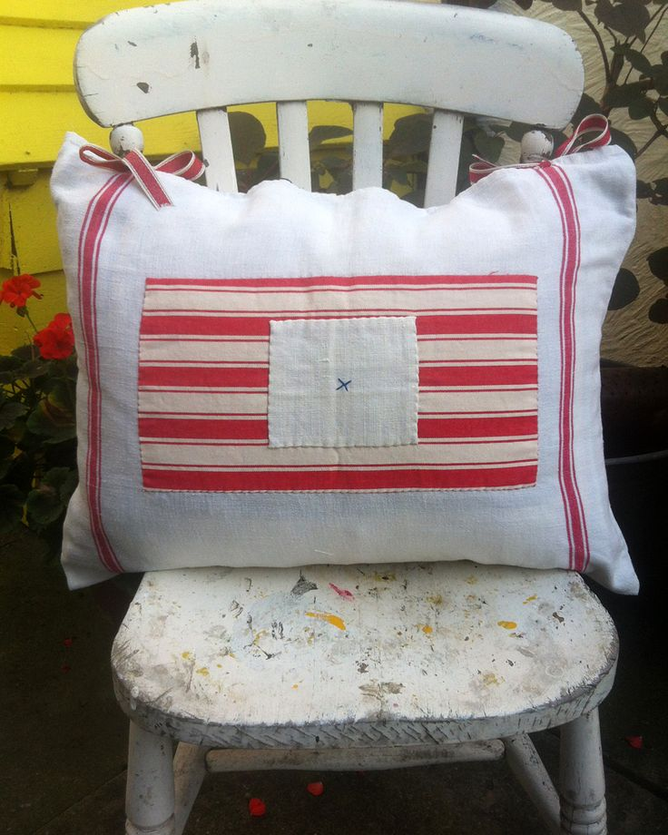 Vintage Cushion, Cream / Red Stripe With Red Ticking Applique. Handmade item. Materials: Vintage Ticking, Tea Towel, Vintage Stripe, Cream Linen, Vintage Linen, Cotton Ribbon, Vintage Button, Embroidered, Vintage Tea Towel, Cotton Material, Linen Material. Ships from United Kingdom. https://www.etsy.com/uk/listing/205164808/vintage-cushion-cream-red-stripe-with?ref=listing-shop-header-0