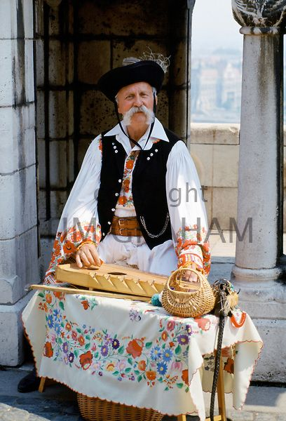 Hungarian man in traditional clothing with Hungarian musical instrument in Budapest, Hungary - Photo by Tim Graham