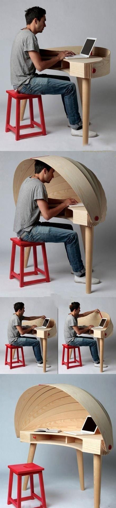A creative computer desk. Withdraw from the outer world if you need to.