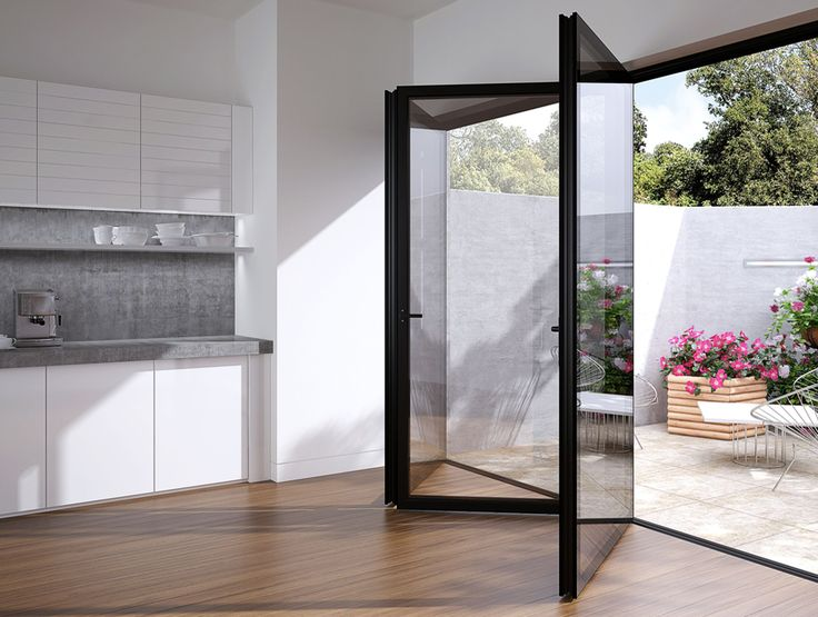 Fully Glazed Doors - the nicest bi-folds I have seen yet as the glass helps to detract from the frame (e.g. soften it).